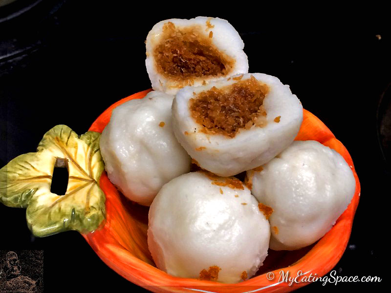 Delicious oil-free, gluten-free Coconut stuffed dumplings made with rice flour and sweetened coconut makes a great sweet snacks or breakfast. In Kerala this sweet is known as kozhukatta.