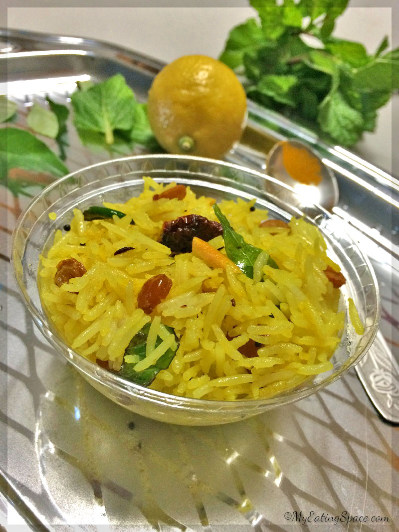 Lemon rice with chickpeas to add the nutty, crunchy flavor. This is the best travel food that is easy to prepare and goes with any side dish, even with pickles or raita.