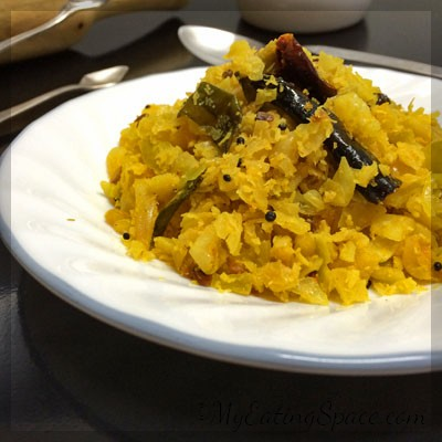 Cabbage Thoran, a colorful and simple to make stir-fry. A single cabbage will make the stir-fry for a large group. A delicious and nutritious dry side dish that tastes great when paired with spicy Kerala style fish curry. The best option for thoran in Onam sadya.