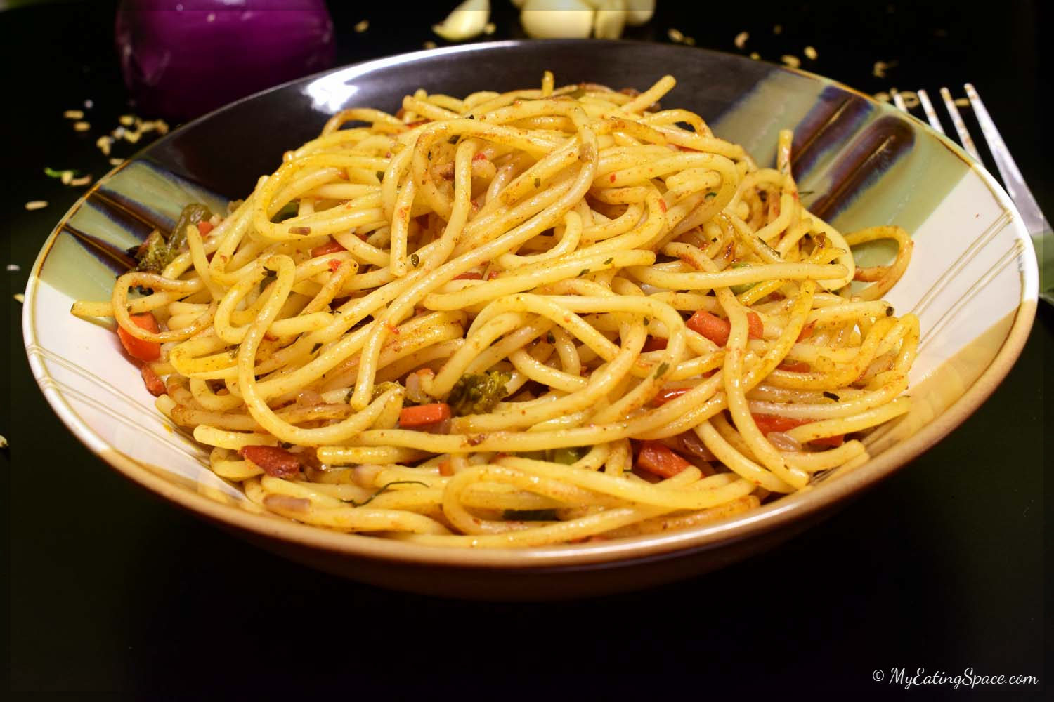 Healthy and easy vegetarian spaghetti recipe that can be prepared in just 30 minutes. The dish is purely vegan. You can add any vegetables, fresh or frozen, to the recipe. They are also great for late night dinner preparations as they don't need any other accompanying dish. More recipes at myeatingspace.com