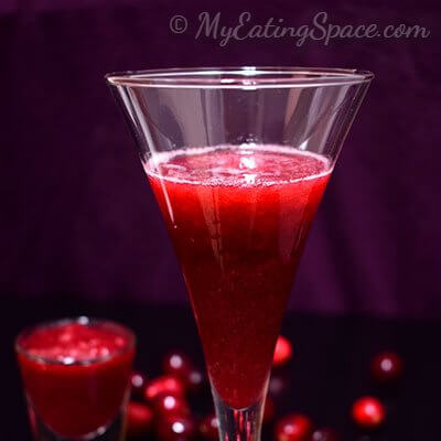 Orange cranberry slush, an instant cool drink made from homemade cranberry sauce. Make the sauce ahead and enjoy a cool slush all year round. More recipes at http://myeatingspace.com/