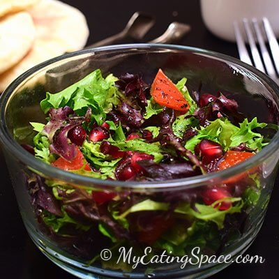 Artisan lettuce salad makes a unique spring flavor. Four types of greens with unique taste mixed with tomato and pomegranate makes an excellent spring salad. More recipes at myeatingspace.com