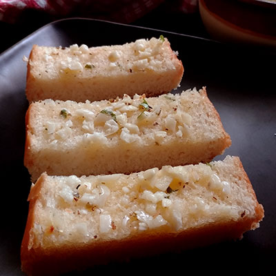 Make a delicious garlic bread from scratch with a simple recipe. Nothing can beat a homemade garlic bread slathered with butter. A must try recipe.