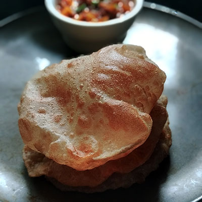 Poori is that staple food of India that knows no boundaries. The deep fried puri made with wheat flour (atta) is one of the delicious Indian flatbreads just like roti.
